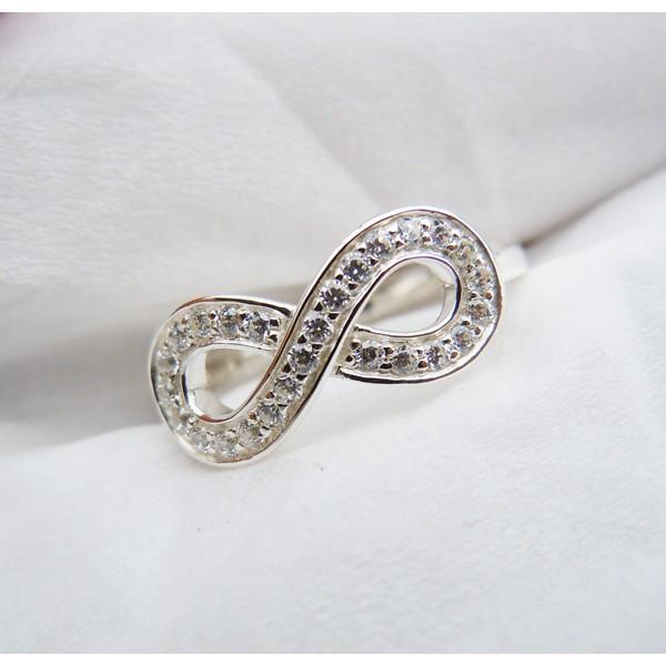 кольца с знаком бесканечности